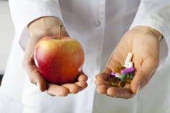 Apple和药物 免版税库存照片