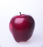 Apple ή κόκκινο μήλο σε ένα υπόβαθρο Στοκ Φωτογραφία