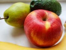 Apple, αβοκάντο, μπανάνα και αχλάδι Στοκ Φωτογραφία