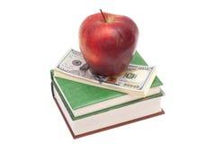Apple, βιβλία και δολάρια Στοκ φωτογραφία με δικαίωμα ελεύθερης χρήσης