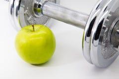 Apple και έννοια ικανότητας βάρους Στοκ Εικόνες