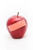 Apple και ασβεστοκονίαμα επίδεσμος ιατρικός Στοκ Φωτογραφία