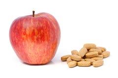 Apple και βιταμίνες στις ταμπλέτες. Στοκ Εικόνα