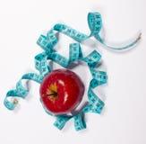 Apple και μέτρο ταινιών, έννοια διατροφής Στοκ φωτογραφία με δικαίωμα ελεύθερης χρήσης