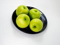 Apple και μαύρο πιάτο Στοκ Εικόνα