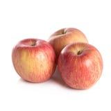 Apple και μια μισή άποψη κινηματογραφήσεων σε πρώτο πλάνο που απομονώνεται στο άσπρο υπόβαθρο Στοκ Φωτογραφίες
