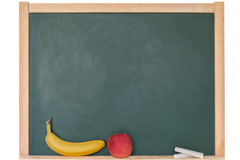 Apple και μπανάνα μπροστά από έναν πίνακα Στοκ Φωτογραφία