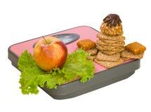 Apple και μπισκότο στην κλίμακα πατωμάτων Στοκ Εικόνες