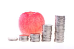Apple και νομίσματα Στοκ Εικόνα