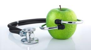 Apple και στηθοσκόπιο - υγιεινή διατροφή Στοκ Εικόνες