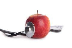 Apple και στηθοσκόπιο Στοκ φωτογραφία με δικαίωμα ελεύθερης χρήσης