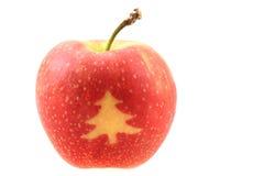 Apple με τα σύμβολα Χριστουγέννων Στοκ φωτογραφία με δικαίωμα ελεύθερης χρήσης