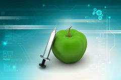 Apple με τη σύριγγα Στοκ εικόνα με δικαίωμα ελεύθερης χρήσης