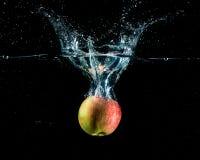 Apple με τον παφλασμό Στοκ Εικόνα