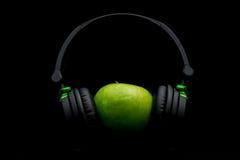 Apple με το ακουστικό Στοκ Εικόνα