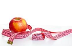 Εκατοστόμετρο και μήλο Στοκ εικόνα με δικαίωμα ελεύθερης χρήσης