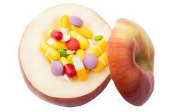 Apple που γεμίζουν με την έννοια φαρμάκων Στοκ εικόνα με δικαίωμα ελεύθερης χρήσης