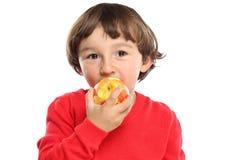 Apple που τρώει τα φρούτα παιδιών παιδιών υγιή που απομονώνει στο λευκό Στοκ φωτογραφίες με δικαίωμα ελεύθερης χρήσης
