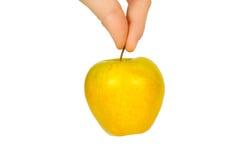 Apple σε ένα χέρι Στοκ εικόνα με δικαίωμα ελεύθερης χρήσης