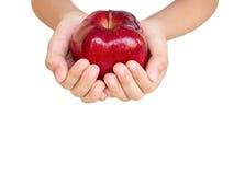 Apple στα χέρια παιδιών Στοκ φωτογραφία με δικαίωμα ελεύθερης χρήσης