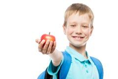Apple στην εστίαση στο χέρι μαθητών ` s Στοκ Εικόνες