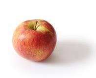 Apple στο γκρίζο υπόβαθρο Στοκ εικόνες με δικαίωμα ελεύθερης χρήσης