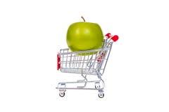 Apple στο κάρρο αγορών που απομονώνεται στο άσπρο υπόβαθρο Στοκ Φωτογραφίες