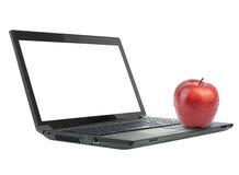 Apple στο lap-top με την κενή οθόνη Στοκ Εικόνα