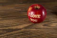 Apple с влюбленностью Стоковая Фотография