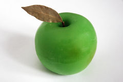 Apple. Made out of wax on a white background Stock Photos