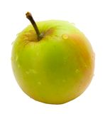 Apple. Fresh green apple with water droplets on a white background stock image