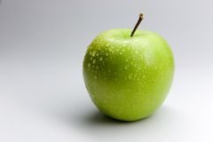 Apple. Wet green apple Royalty Free Stock Images