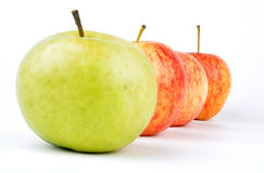 Apple. A green and red apple queuing up isolated on a white background with shadows Royalty Free Stock Photography