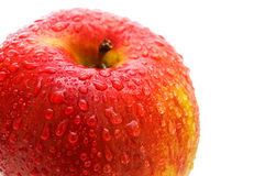 Apple. Beautiful close up red apple with drops Royalty Free Stock Photo
