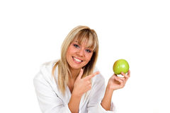 Apple. Young blond girl with green apple in her hand Stock Photos