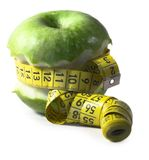 Apple. Autumn, centimeter, centimetre, diet, drew, drop, eat, fall, fruit, green, measure, vitamin, water, yellow Royalty Free Stock Images