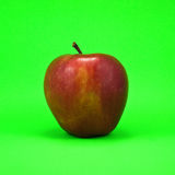 Apple. Dark-red apple. Isolated on green background Stock Photo