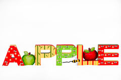 Apple. The word apple with decorated letters and illustrated with red and green apples Royalty Free Stock Photography