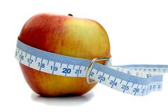 Before Apple. Braeburn Apple with tape measure Stock Images