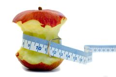 After Apple. Apple with Tape measure Royalty Free Stock Photography