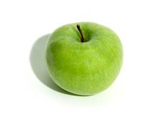 An apple. Juicy apple aganst white background royalty free stock photo