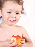 Apple. Baby eating a apple at home Royalty Free Stock Images