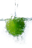 Apple. Fresh green apple in bubble water, pouring water on isolated background Stock Image