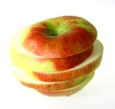 Apple. In slices, ed with green Royalty Free Stock Photos
