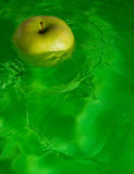 Apple. Green apple and green water Royalty Free Stock Image