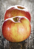 Two apples on wood surface Royalty Free Stock Photo