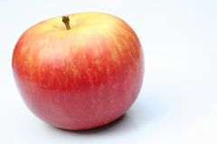 Apple. Red and yellow Fuji apple in natural light royalty free stock photography