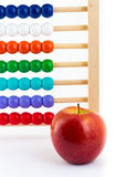 School. An apple and an abacus royalty free stock photo