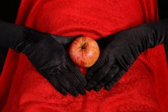 Apple on abdomen. Red apple on abdomen with hand Stock Photography