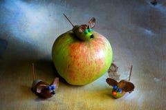 Apple acorn mouse figure wooden table. Apple acorn mouse figure handmade wooden table stock photos